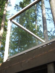 Everett WA Deck Railing Installation Brown Aluminum Glass
